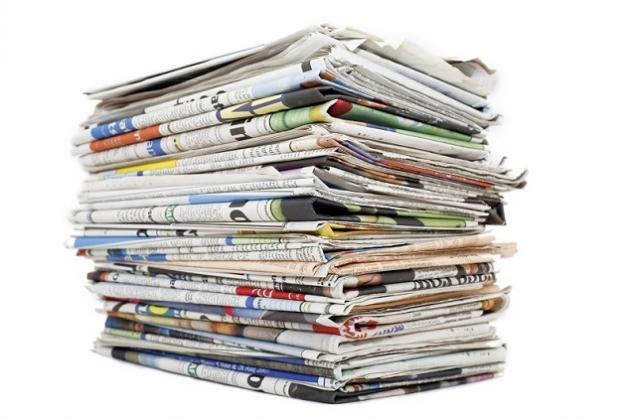 Memanfaatkan Koran Bekas